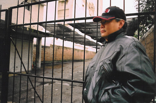 Cheuk in a street