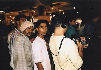 Ajay and spectators at market