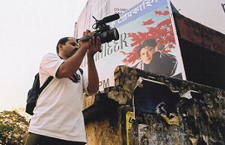 Ajay shooting at billboard
